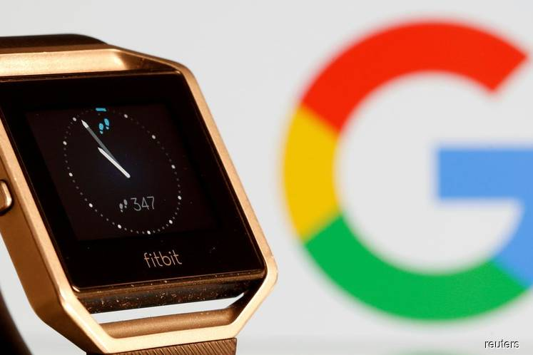 A Fitbit Blaze watch is seen in front of a displayed Google logo in this illustration picture taken on Nov 8, 2019. (Photo by Dado Ruvic/Reuters File Photo)