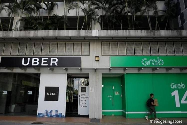 Competition watchdog slaps S$13m fine on Grab, Uber over merger