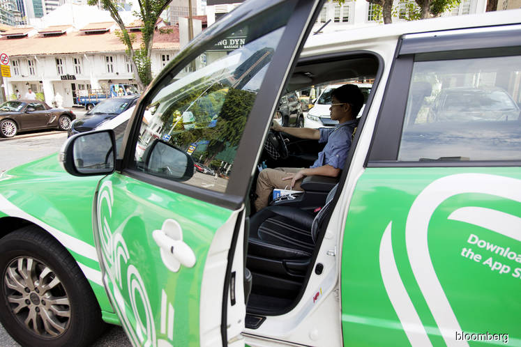 Grab is said to have discussed buying Asia payments startup 2C2P