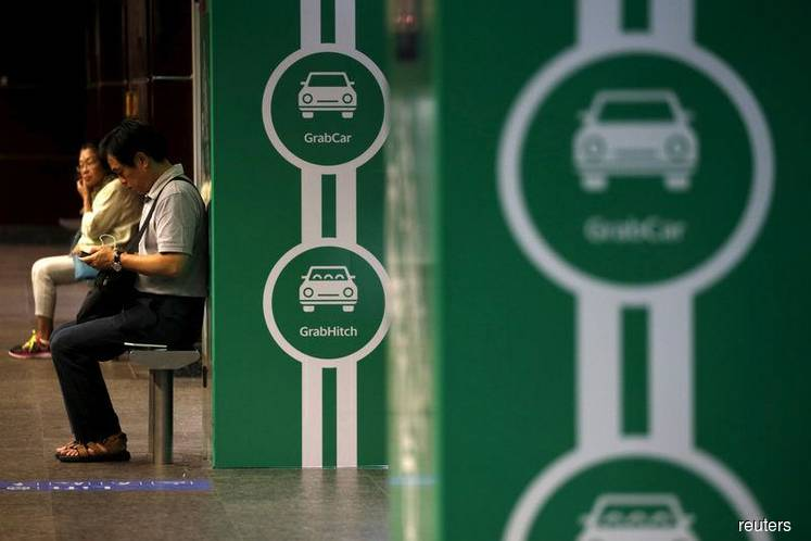 SoftBank and ride hailing app Grab investing $2 billion in Indonesia