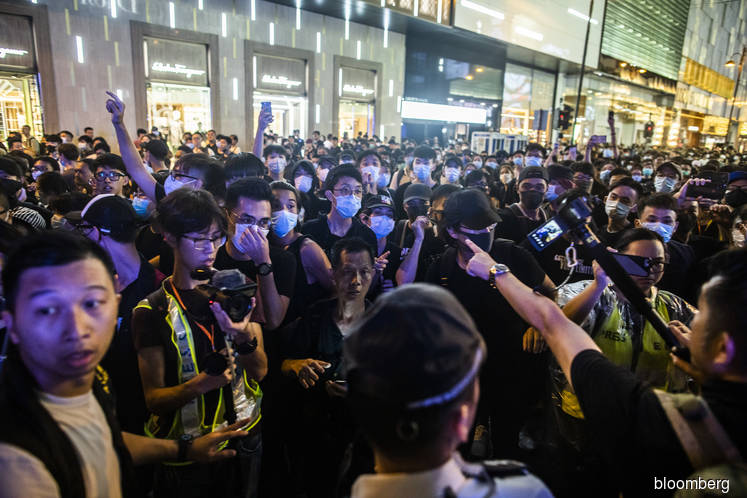 Protesters again take to the street in Hong Kong