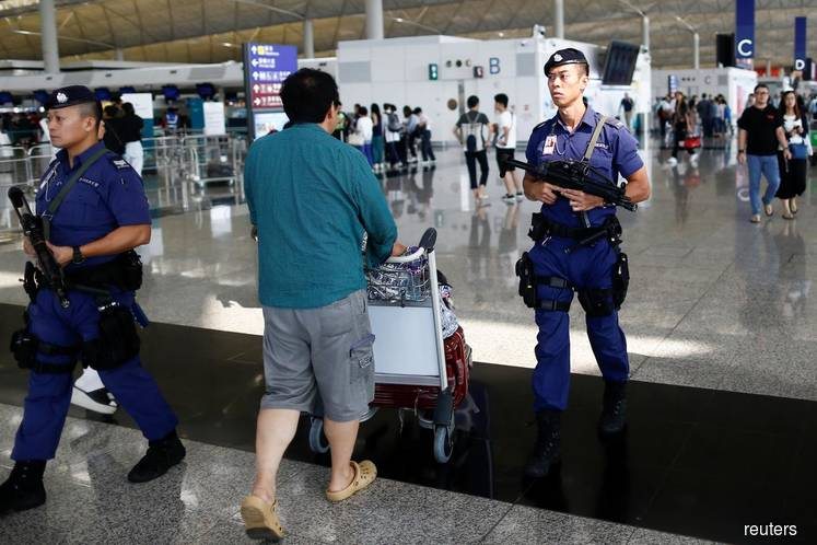 Hong Kong airport reopens amid warnings over pro-democracy protests