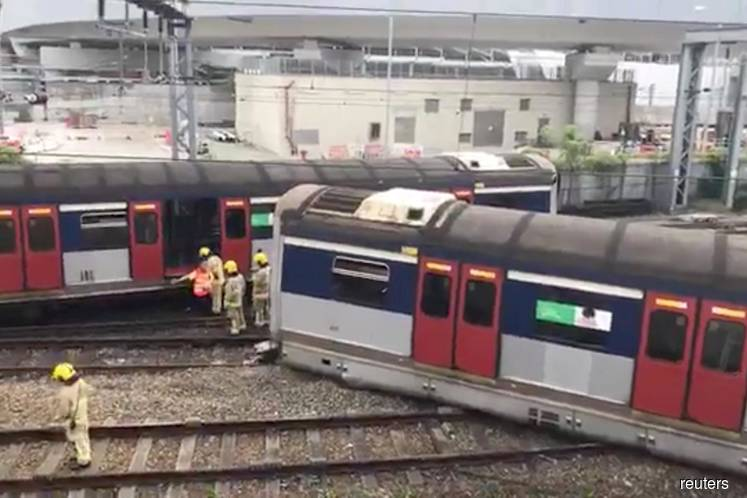 Eight injured after Hong Kong train derails at rush hour