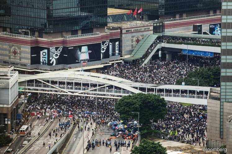 Explainer: Why proposed changes to Hong Kong's extradition law are fuelling protests