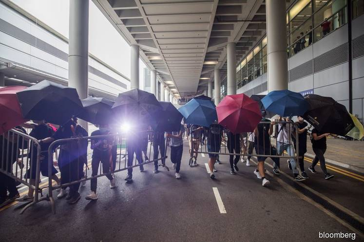 'Spare our passengers': Hong Kong airport's plea to protesters