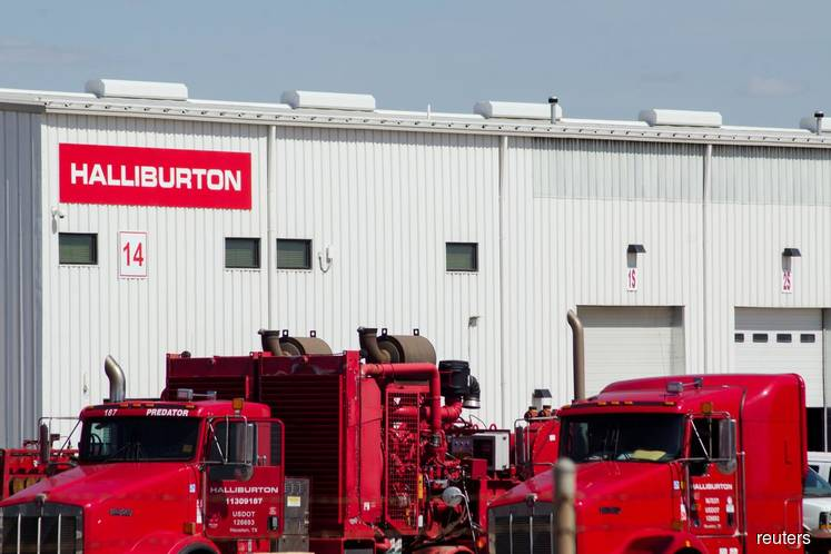 Halliburton vows more cost cuts as shale demand dwindles, shares rise