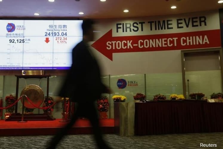 HK stocks edge up as hopes of Fed rate cut counter growth worries