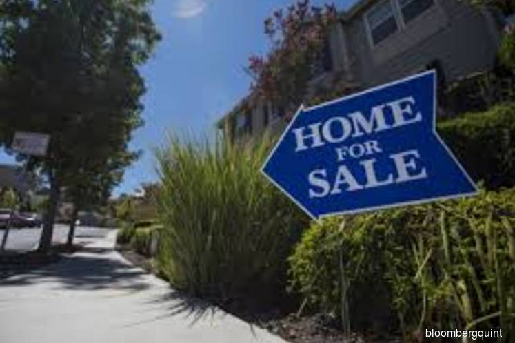 Home prices in 20 U.S. cities rise by least in four years