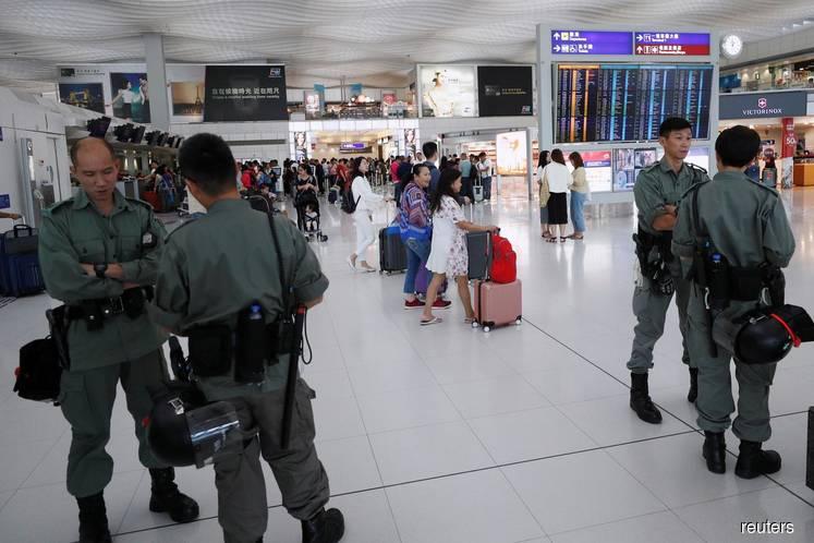 Hong Kong to allow airlines to keep airport slots despite cutting capacity