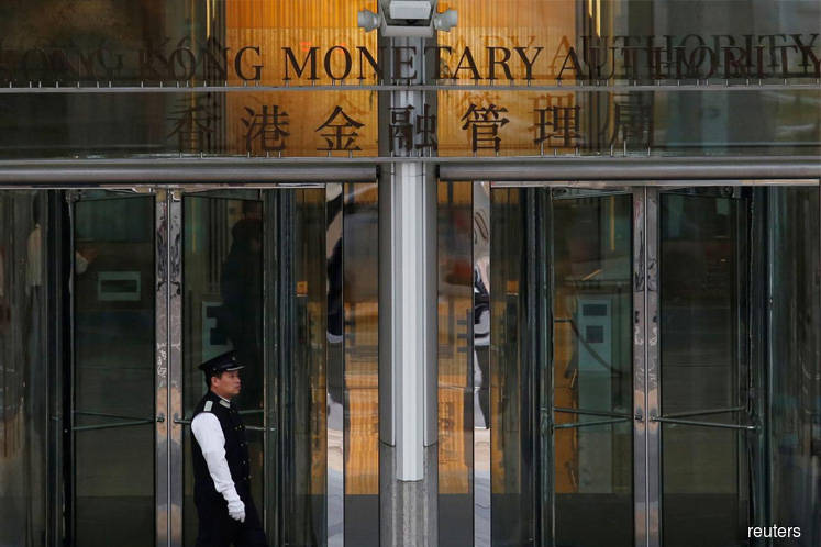 Hong Kong's central bank cuts interest rate after Fed move