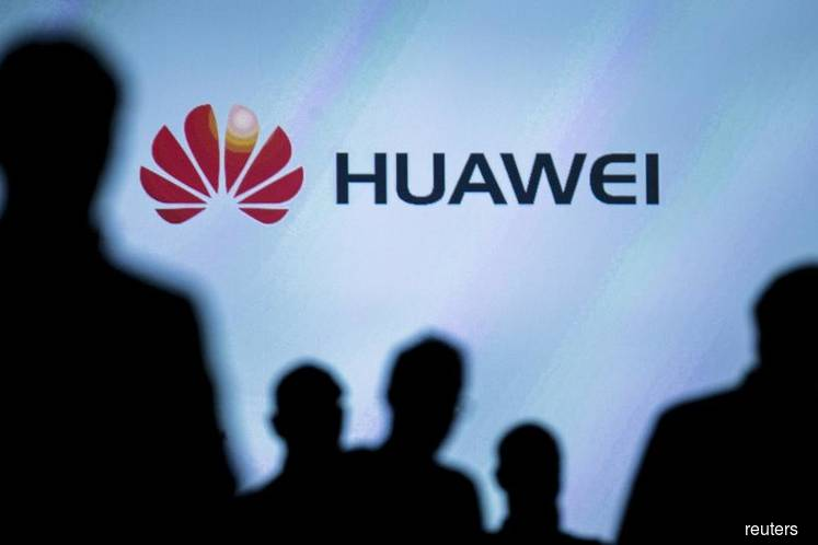 Trump expected to sign order paving way for US telecoms ban on Huawei
