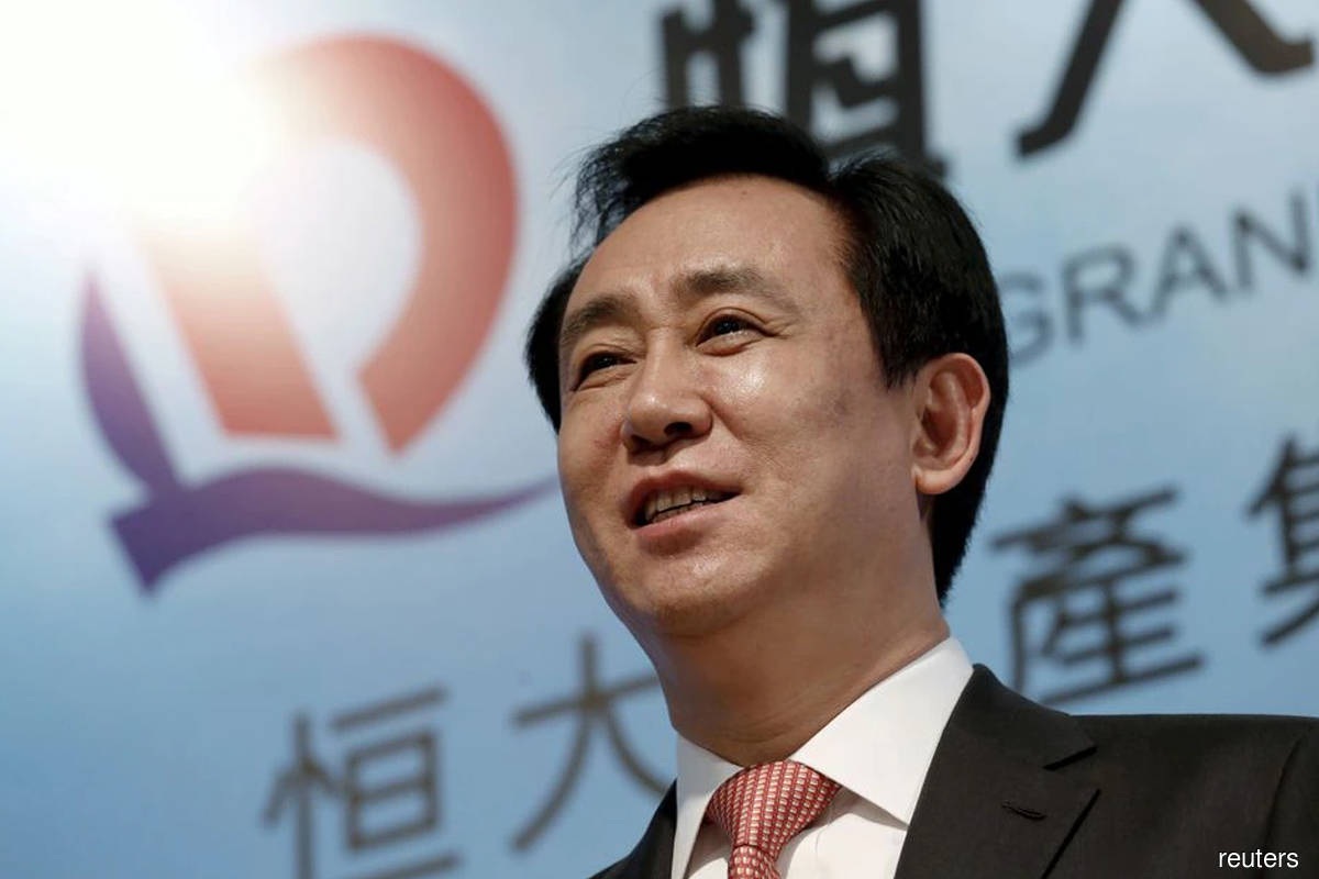 China Evergrande chairman says to ensure home deliveries and wealth products redemption