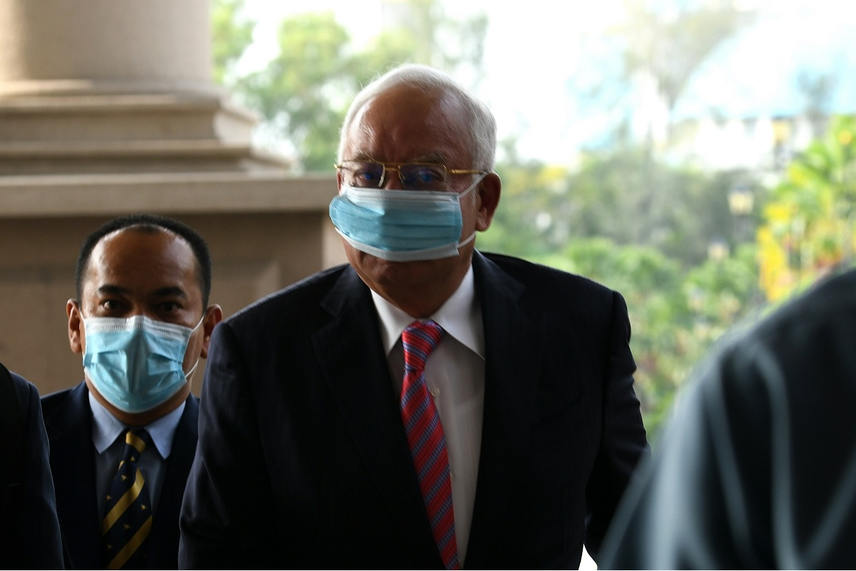 Najib faces four counts of power abuse to enrich himself with RM2.3 billion from 1MDB, and 21 counts of laundering the same amount. (Photo by Shahrin Yahya/The Edge)