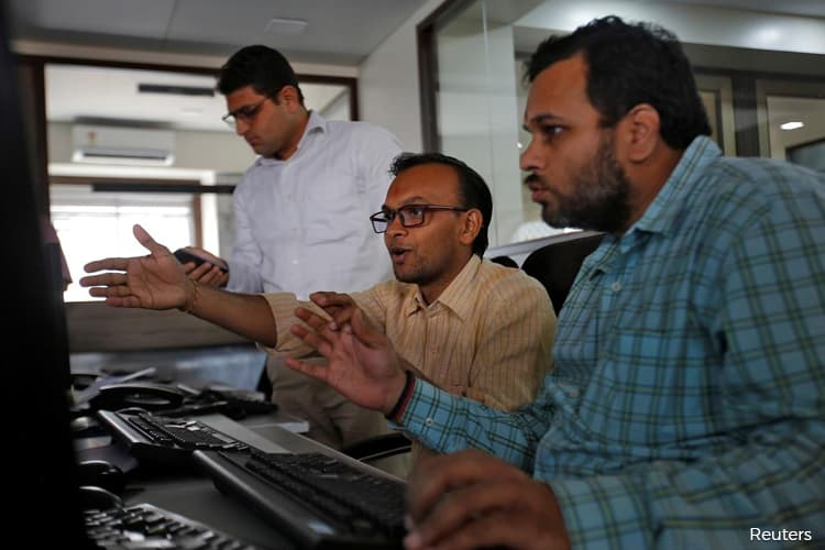 Trading in Indian stocks halted as virus panic triggers 10% plunge