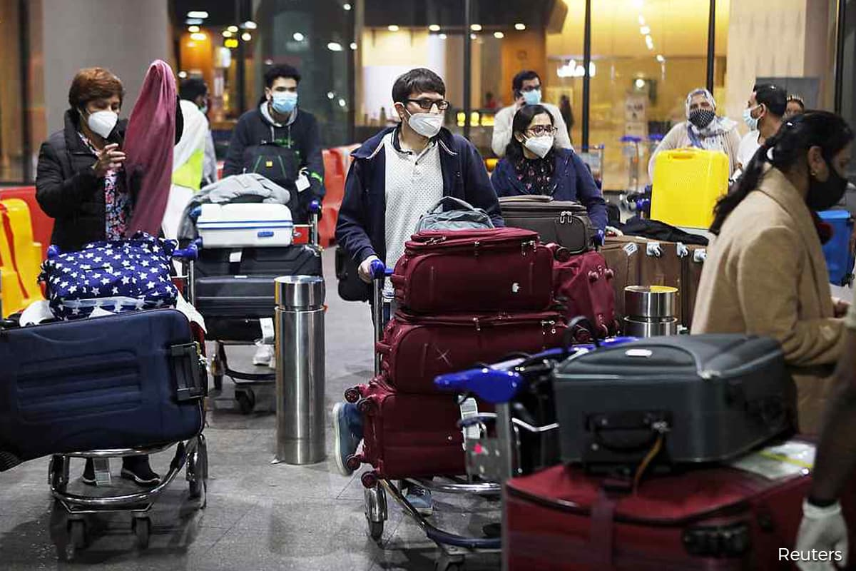 India to track down arrivals from Britain to try to stop new virus strain