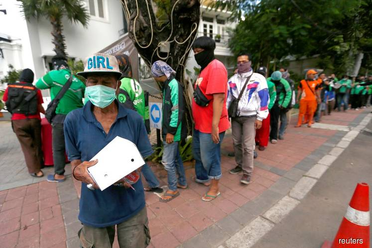 Covid-19: Indonesia makes wearing of face masks compulsory when away from home