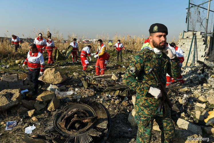 Iran says crash jet tried to turn back, while Ukraine probes missile theory