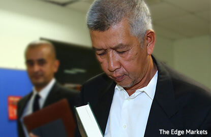 SC charges Ishak Ismail for making misleading statement, insider trading of Kenmark shares