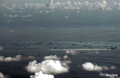 US plans third patrol near disputed S.China Sea islands - source