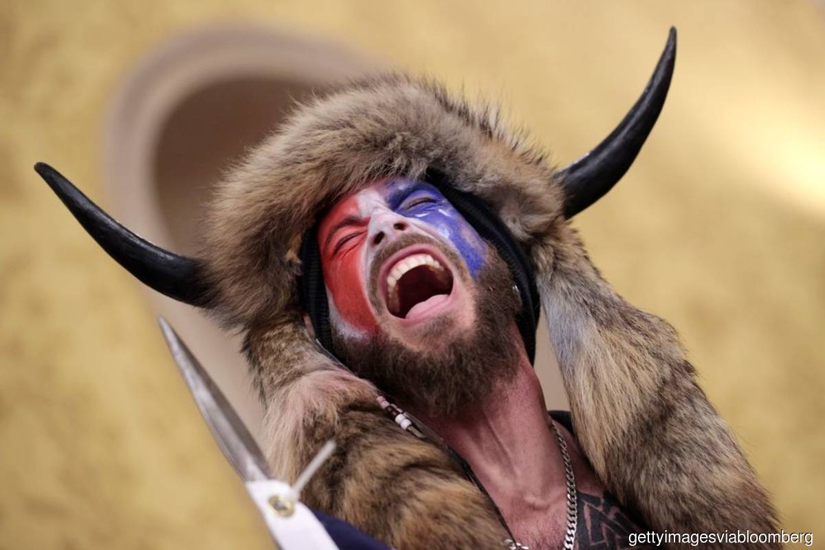 Man in Viking garb among three charged by United States for riots