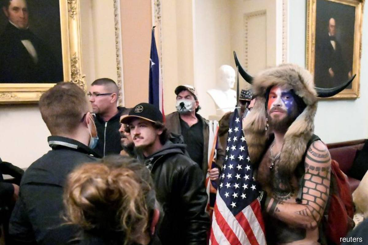 More Capitol rioters in viral posts arrested, senator urges social media providers to keep data