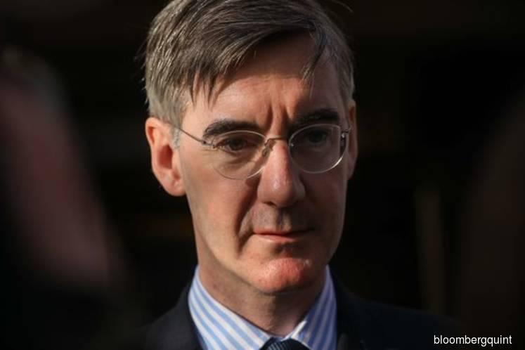 Johnson's tories stumble as senior minister forced to apologize