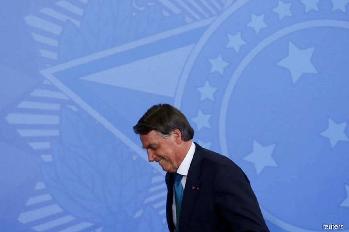 Brazil's Bolsonaro should face homicide charge for Covid-19 errors, says Senate report