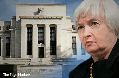 Fed keeps rates unchanged, sets up possible December hike