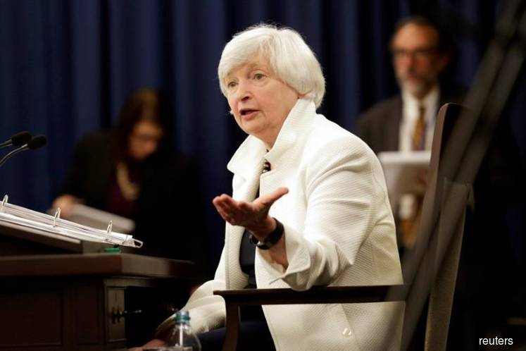 Yellen says watching inflation closely but economy is strong