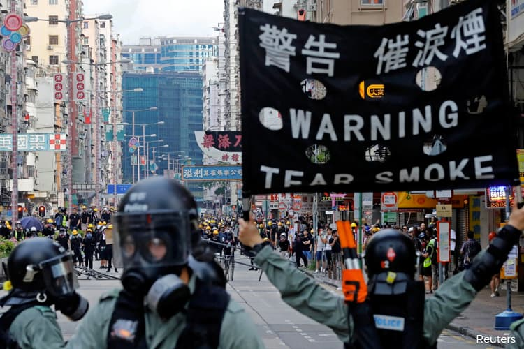 Japan to Raise Hong Kong Worries With China as Tourist Arrested