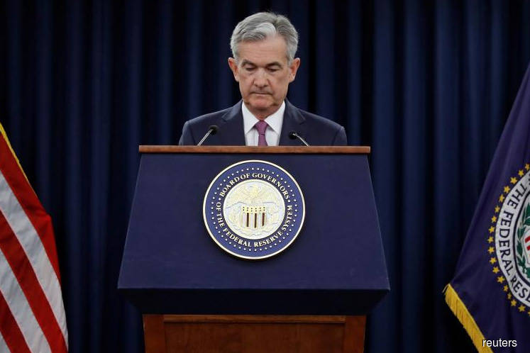 Fed lifts rates amid stronger inflation, drops crisis-era guidance