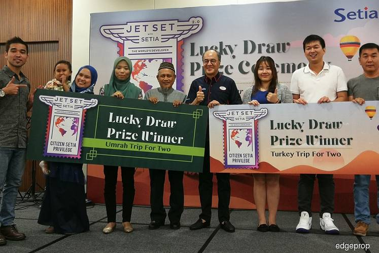 SP Setia presents travel packages worth RM150,000 to buyers
