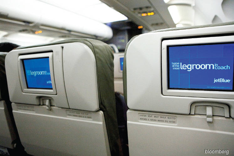 Travel: Airline seatback screens may be an endangered species