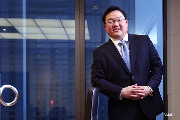 How did Jho Low allegedly spend the money from 1MDB?