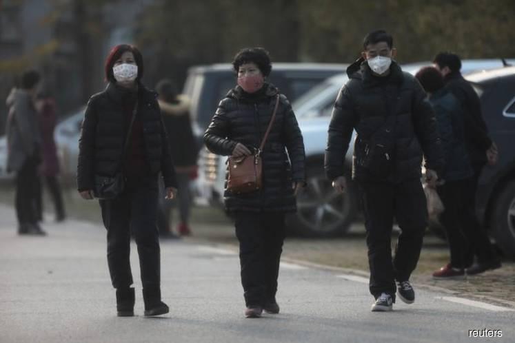 Australia to screen some flights from China, warns coronavirus difficult to stop