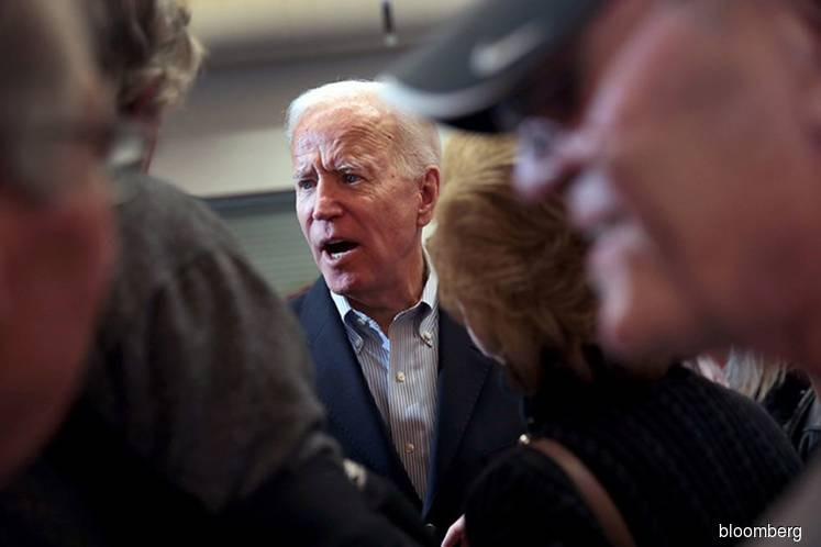 Biden Says He'd Consider Harris for VP