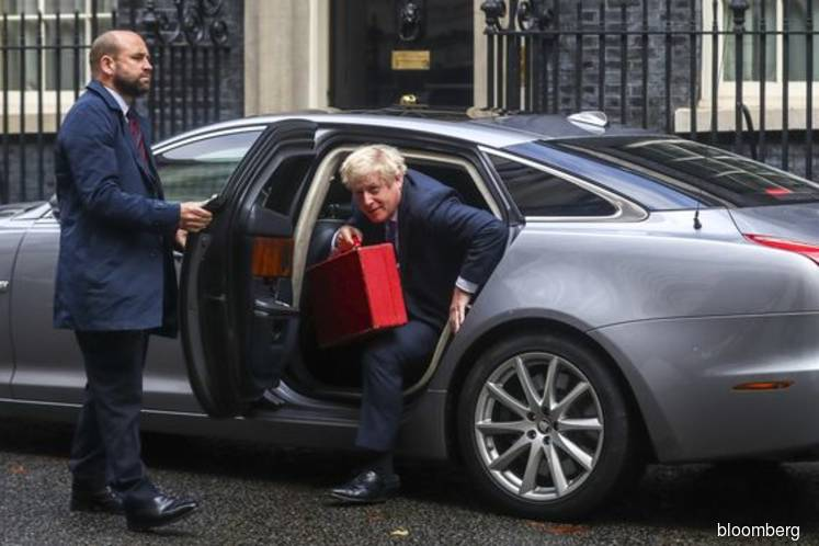 Johnson dragged back to Parliament to face fury