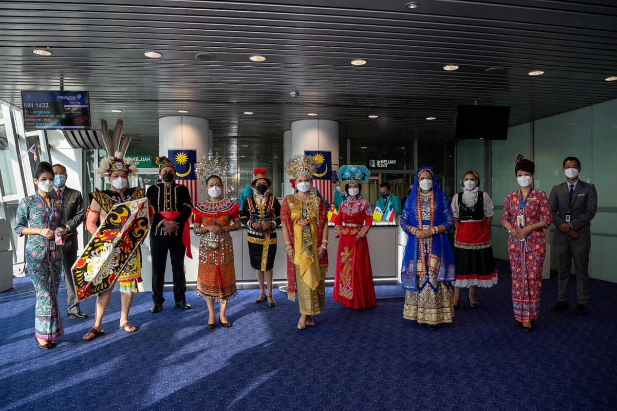 Malaysia Airlines crew and employees dressed in multi-ethnic traditional costumes surprised passengers at the boarding gate in conjunction with Malaysia Day.