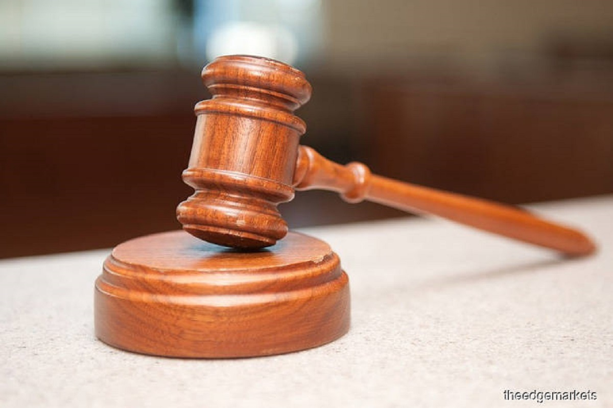 Businessman claims trial to bribery charges