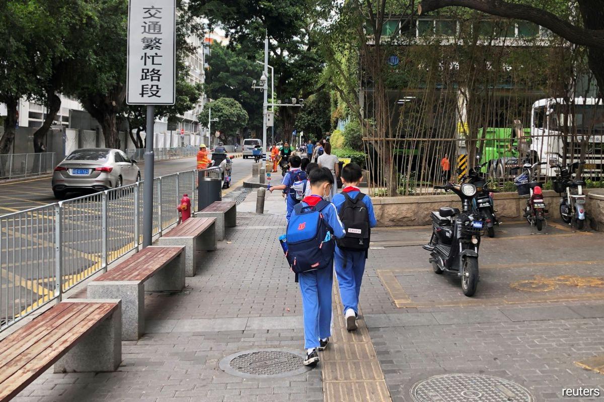 Children leave a school in Shekou area of Shenzhen, Guangdong province, China.