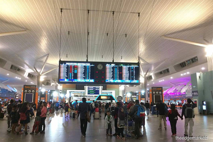 Only flight information display system at klia2 working now, IT glitch still unresolved at both terminals