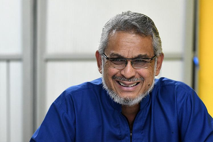Court advises Khalid Samad, FMT to settle defamation suit amicably