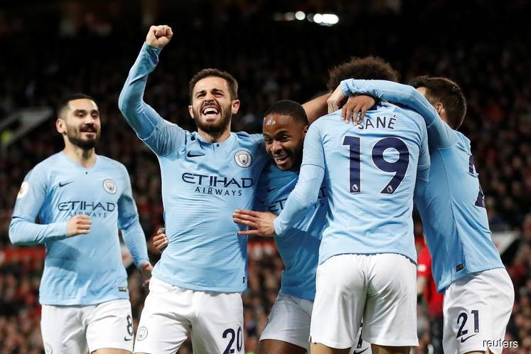 City take big step towards title with derby win at United