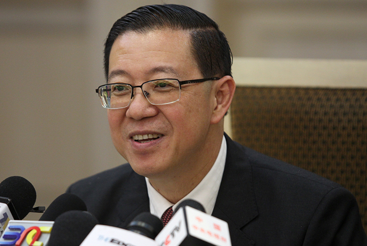 Putrajaya not cutting civil service workforce — Guan Eng