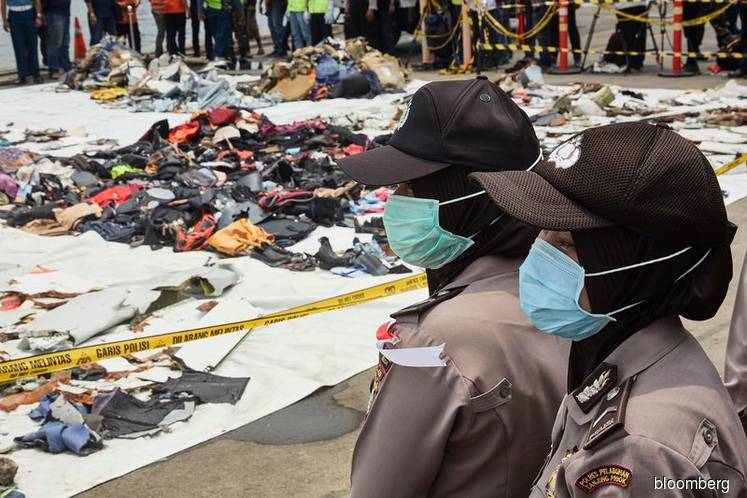 Crashed Indonesian plane's fuselage found, missing black box heard