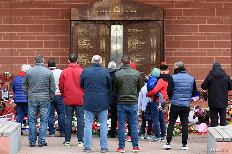 Liverpool falls silent to remember victims of Hillsborough disaster