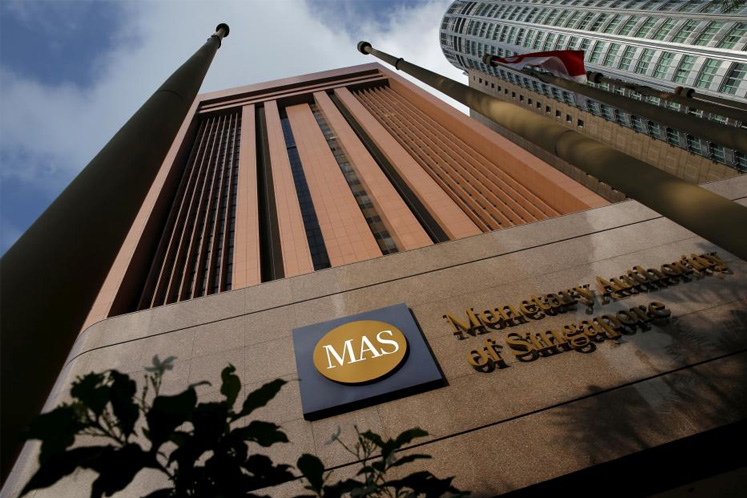 Singapore central bank brings forward policy decision, firming easing bets
