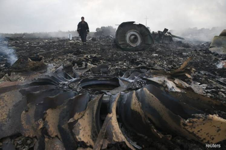 Britain says Russia must cooperate fully with MH17 prosecution