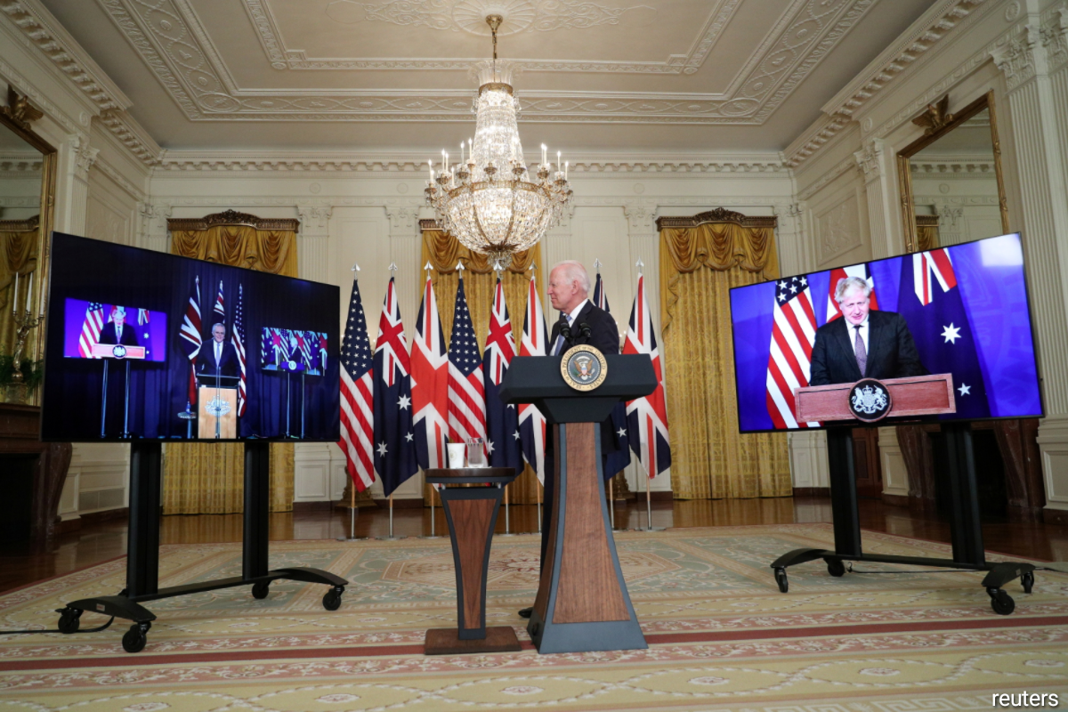 U.S. President Joe Biden delivers remarks on a National Security Initiative virtually with Australian Prime Minister Scott Morrison and British Prime Minister Boris Johnson, inside the East Room at the White House in Washington, U.S., September 15, 2021. Reuters