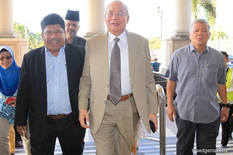 Najib arriving at the Kuala Lumpur Courts Complex for his SRC trial today. (Photo by Shahrin Yahya/The Edge)